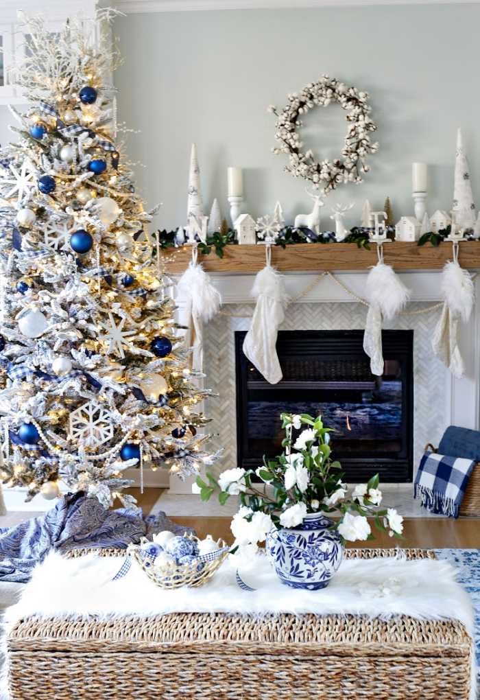 Room decorated in blue and white christmas tree fireplace stockings