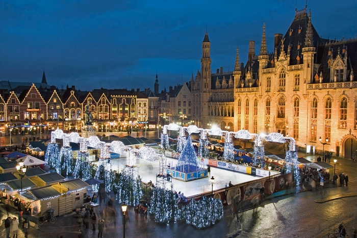Bruges square traditional buildings Christmas lights ice skating ring