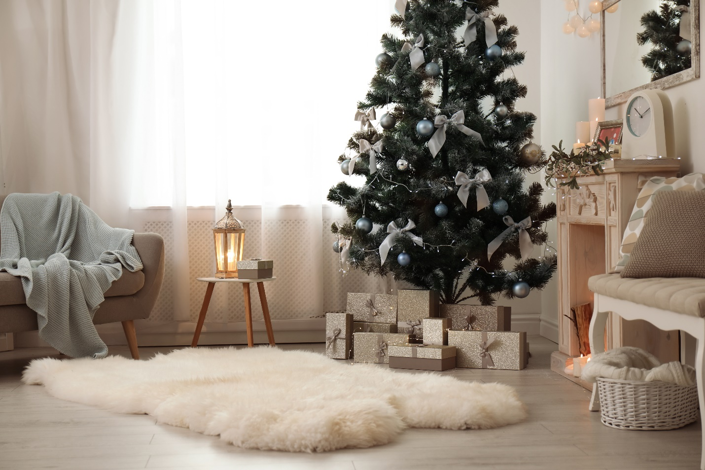 Cozy living room with small Christmas tree and presents under it