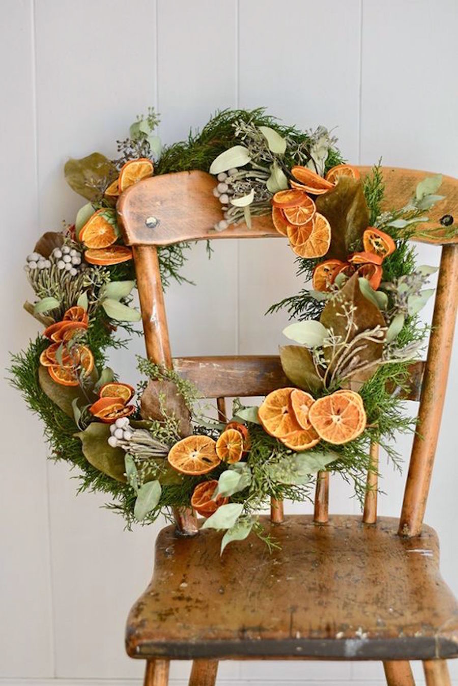 Christmas dried Fruity Wreath on a wooden chair