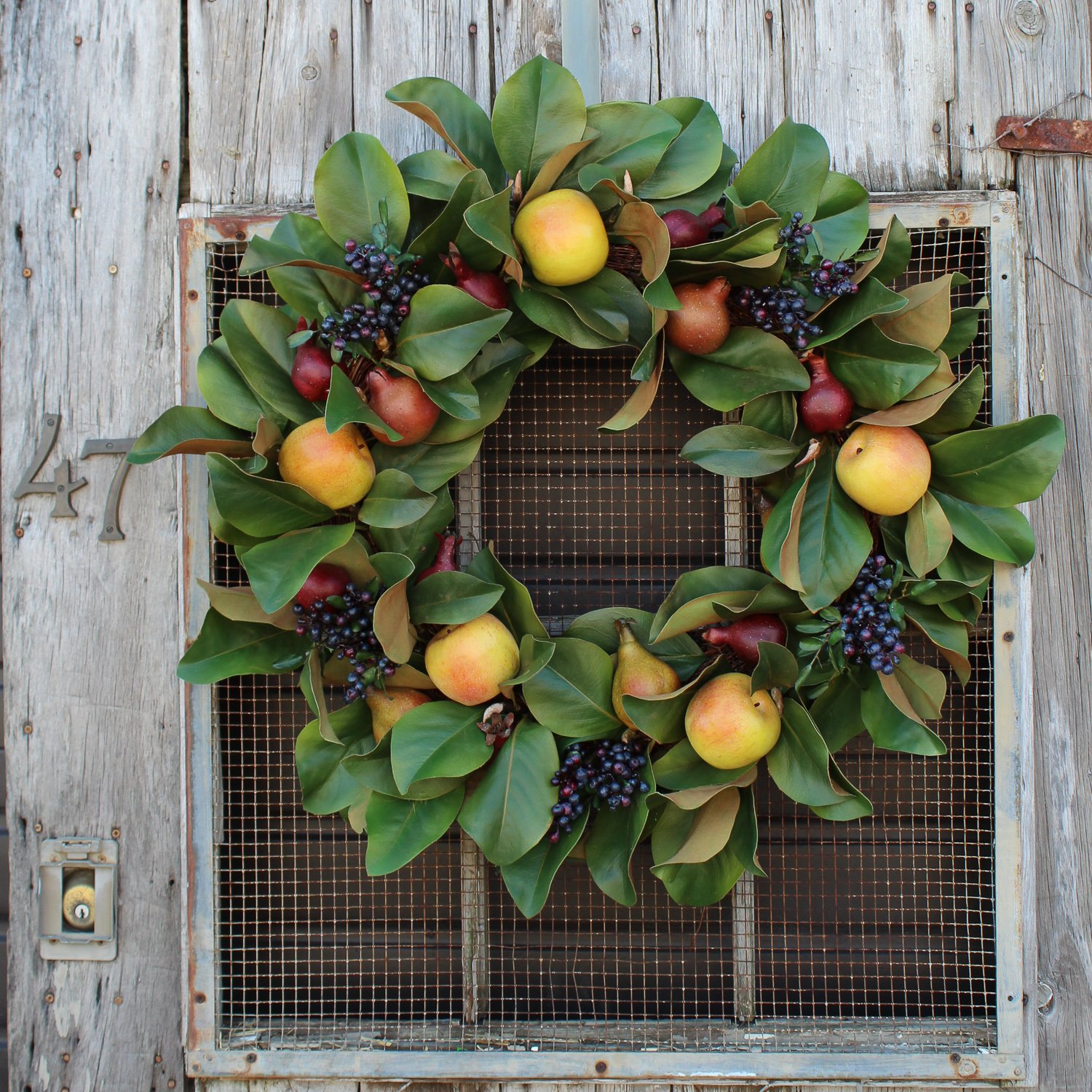 Christmas wreath with apples green leaves berries and fruits