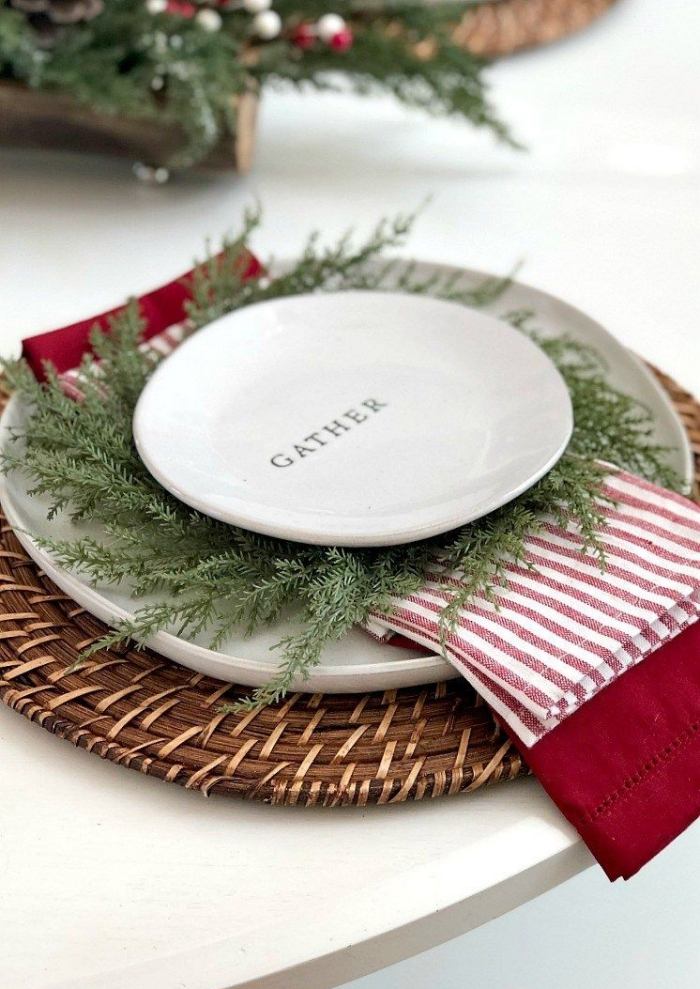 Christmas rustic table setting white plate gather green branches