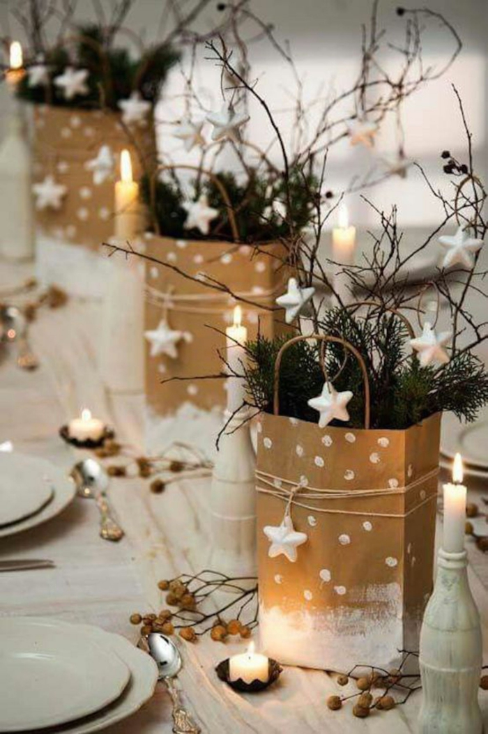 Christmas table centerpiece idea stars gift bags branches candles
