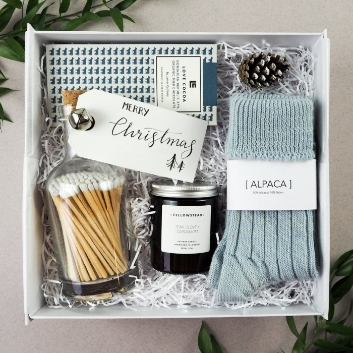 Gift box in blue with socks and other items
