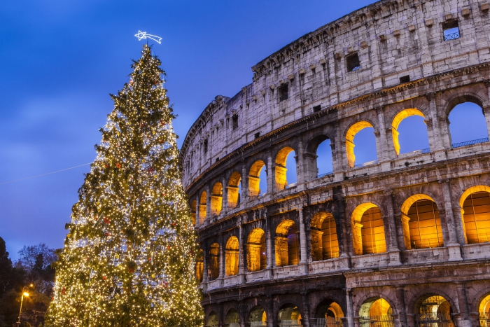 The Colosseum at night large Christmas tree in front