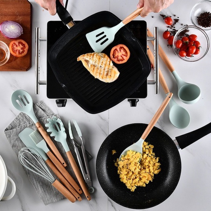 Housewarming gifts wooden kitchen utensils light blue frying pan fish and eggs