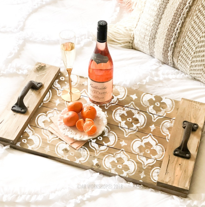 Unique wooden serving tray with white pattern wine bottle elegant tall glass and tangerines