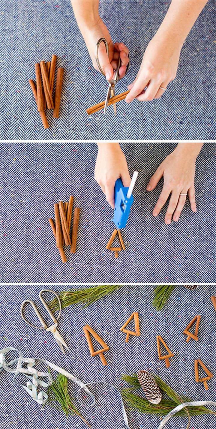 woman crafting with cinnamon sticks scissors glue gun DIY