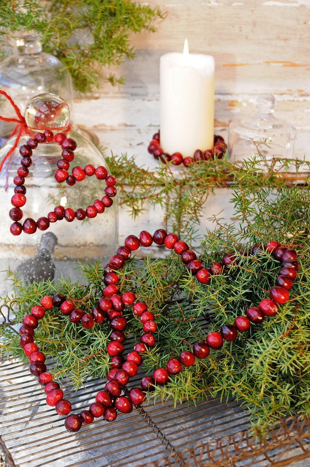 Cranberry Christmas hearts decorations green branches candle