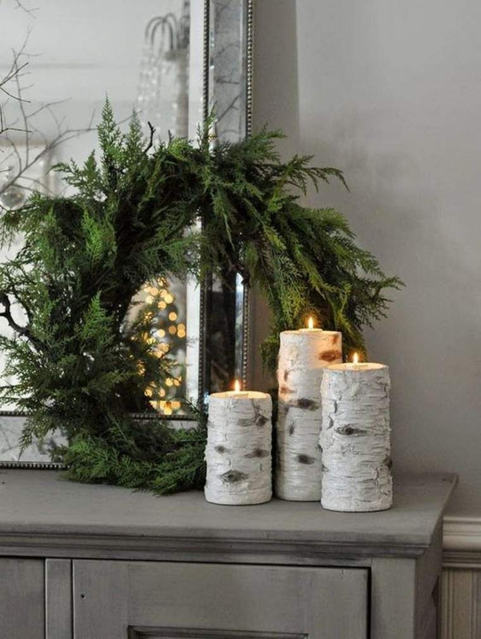 Christmas trends large green wreath natural wood candle holders