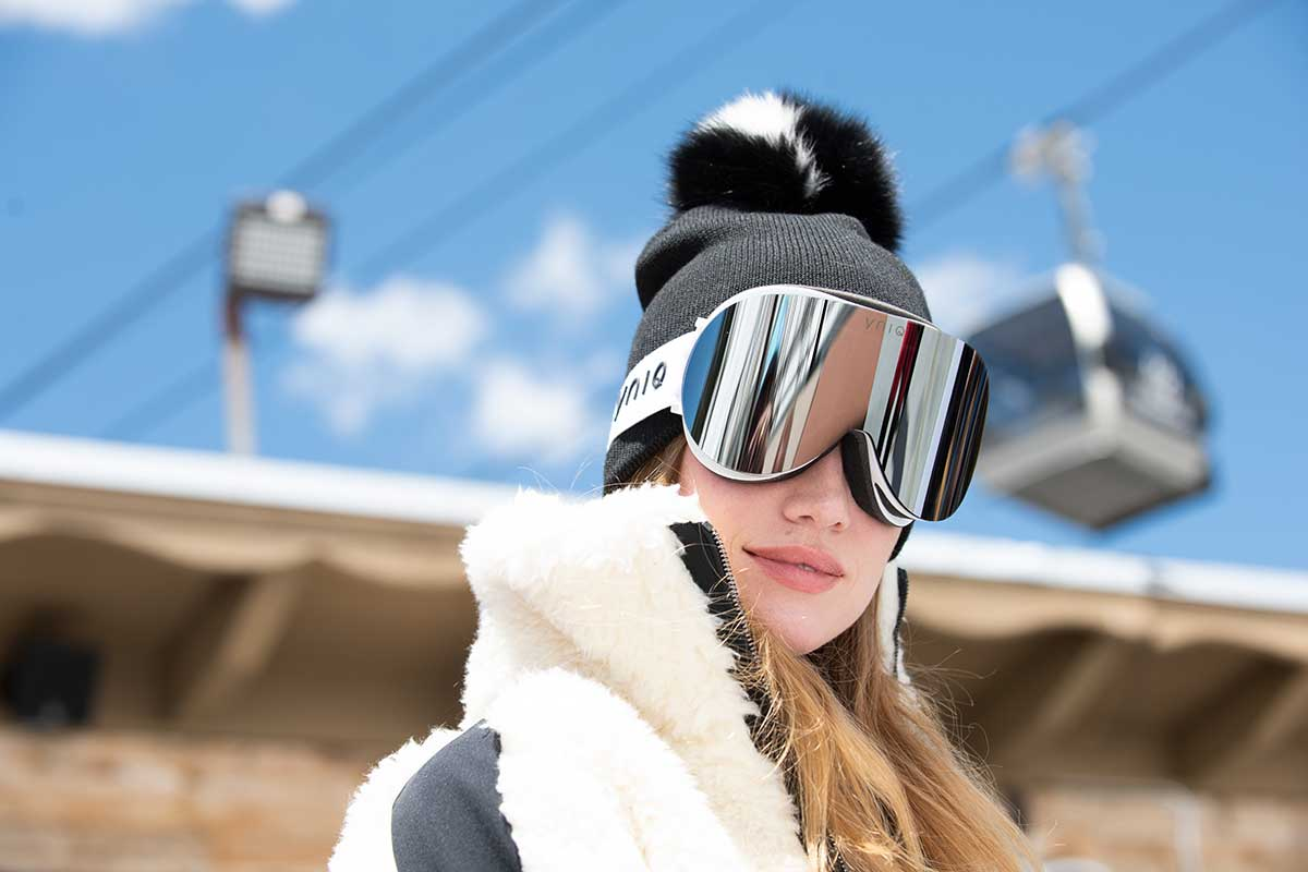 woman skiing with hat and extra large goggles ski wear
