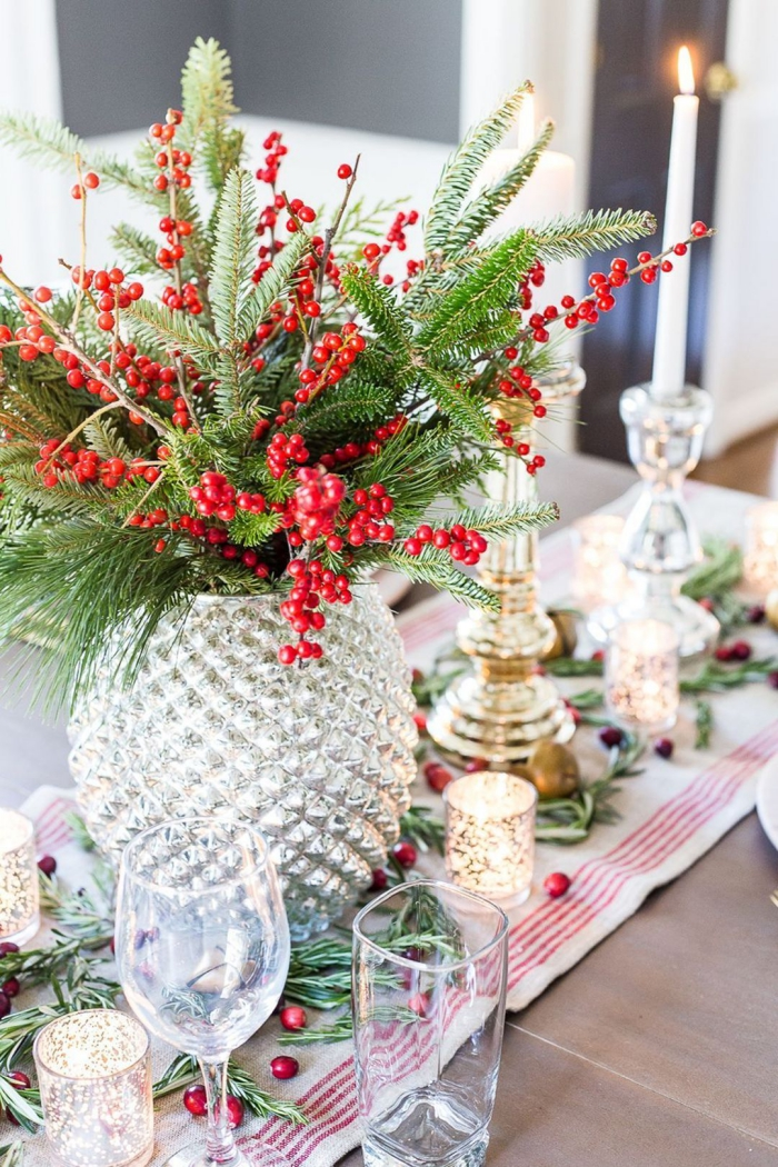 Floral Christmas table centerpiece glass vase berries evergreen branches candles