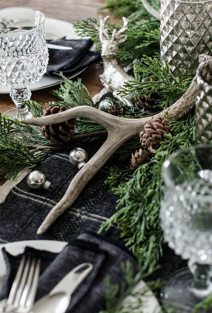 Christmas decoration ideas pinecones green branches horns on a table