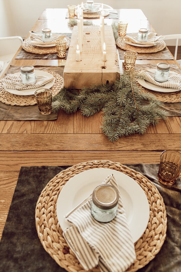Wooden table decorated with natural elements evergreen branches wooden candleholder