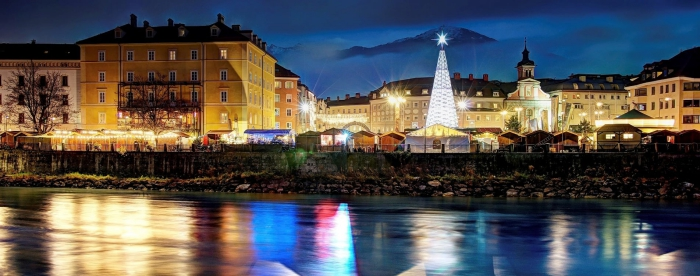 Innsbruck Christmas Market view from the river tall christmas tree at night