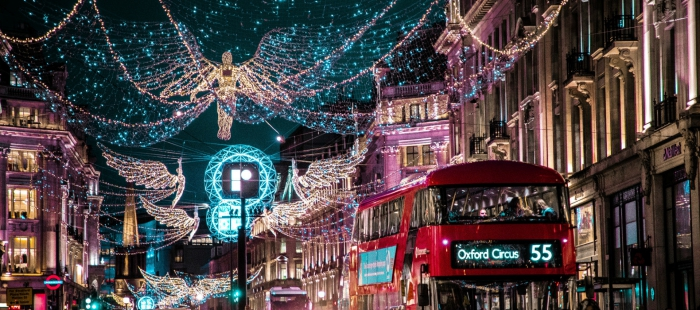 street in london with double decker bright christmas decorations
