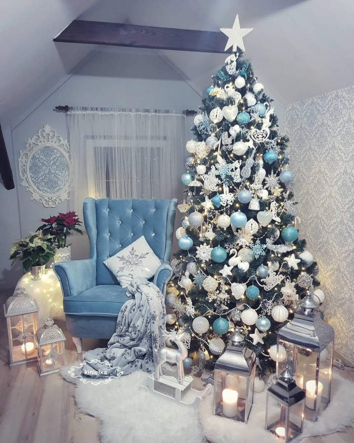 Attic pale blue reading room with white and blue christmas tree reading chair lanterns