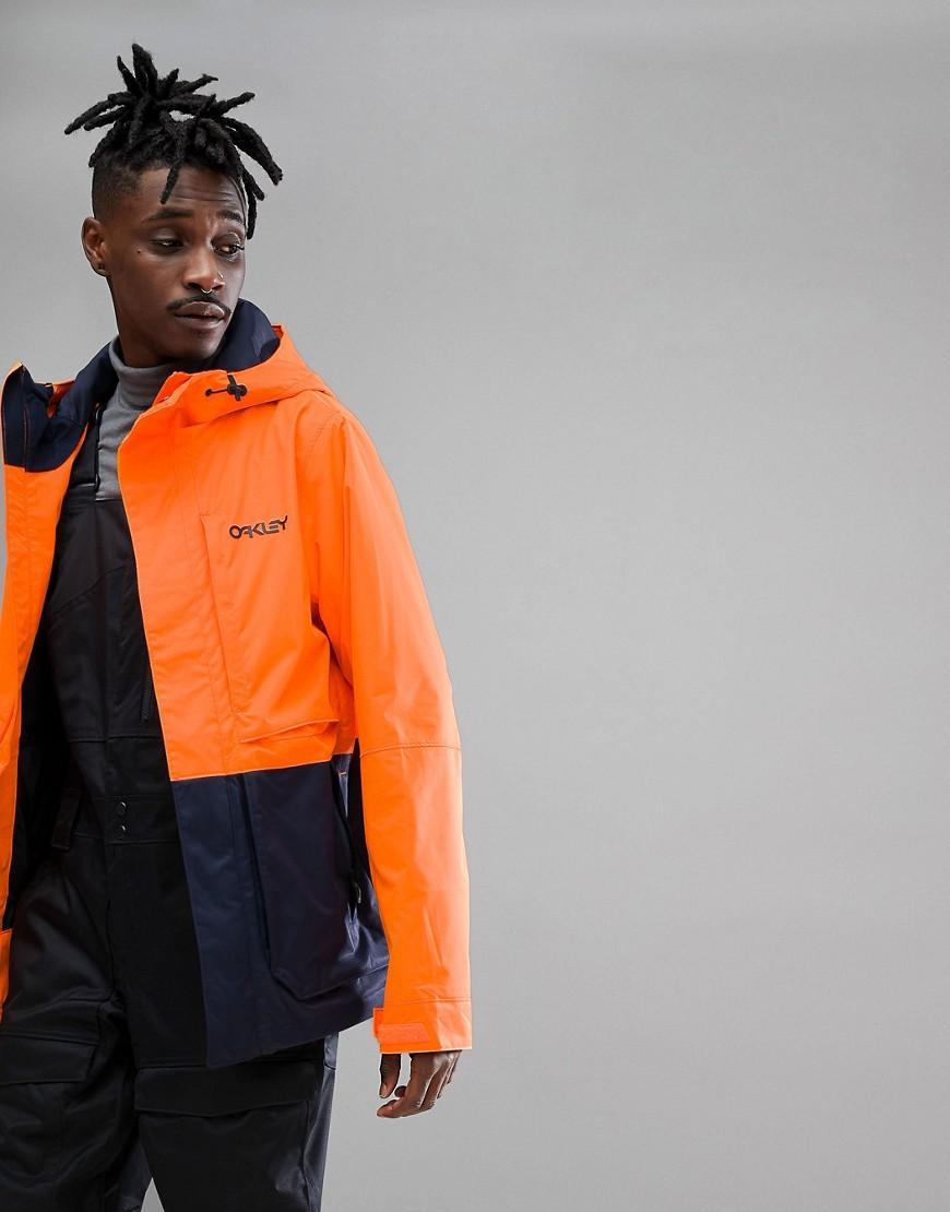 Neon orange ski wear man in orange and black ski wear