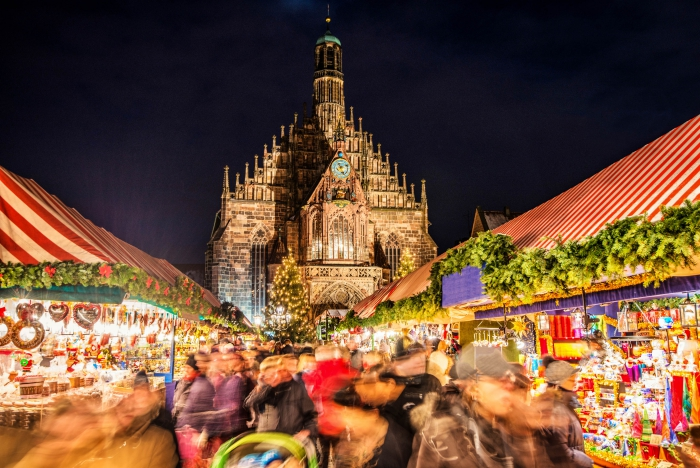 Crowd of people at the Nuremberg Christmas market at night Christmas stands city cathedral