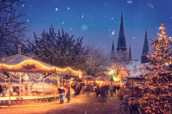 romantic winter breaks Bavaria christmas market at night christmas tree festive lights snow