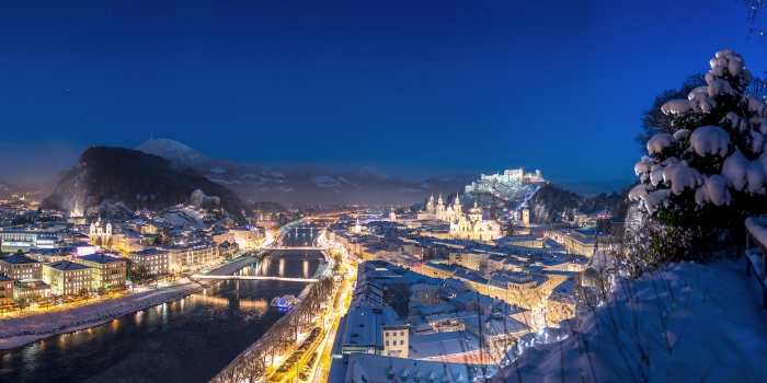 View on snowy Salzburg from above street lights