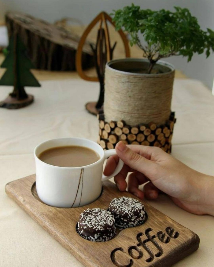 Cute wooden serving tray cup of coffee and two sweets wooden items