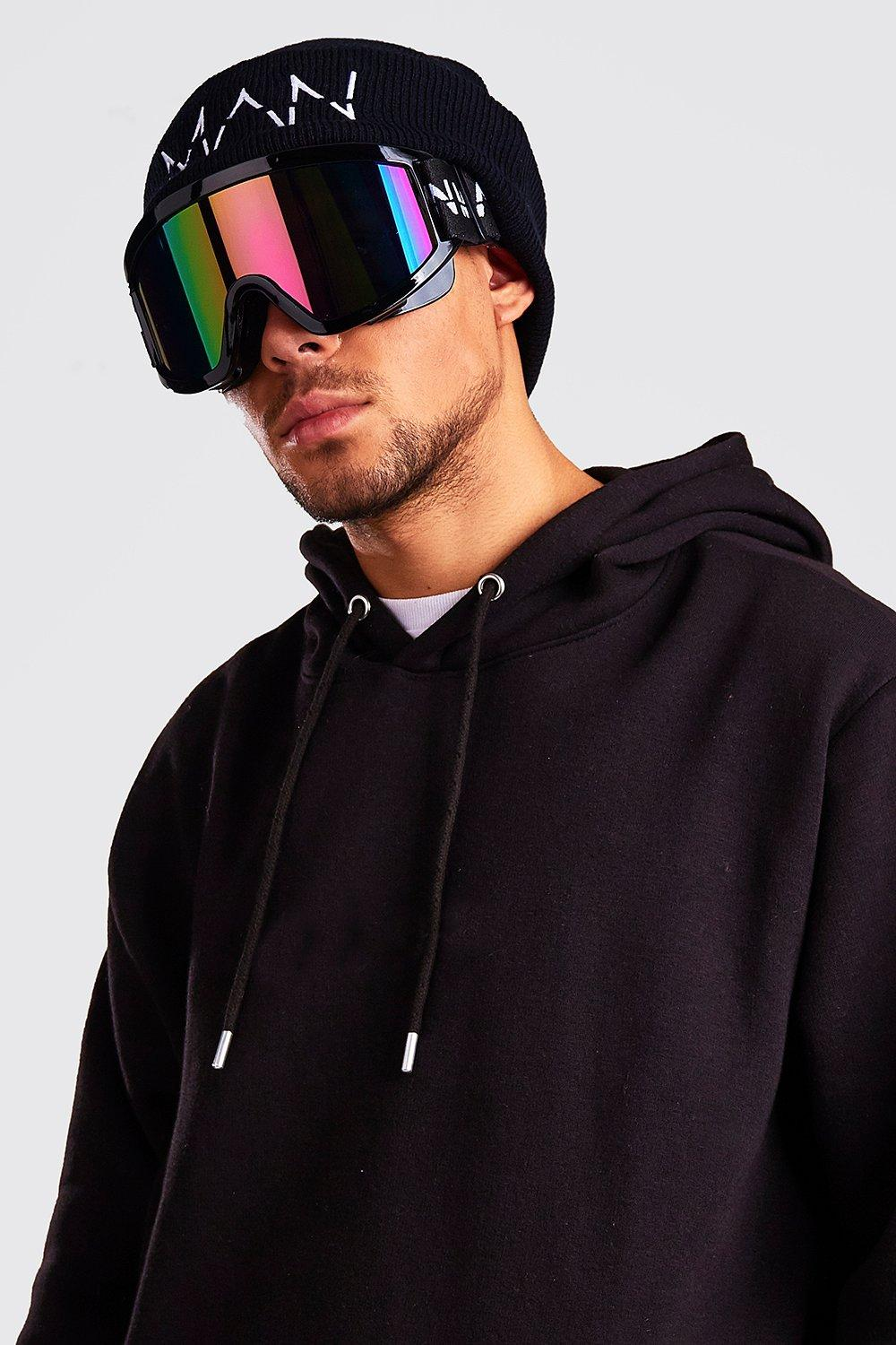 Ski wear trends man with extra large ski googles black hoodie and hat