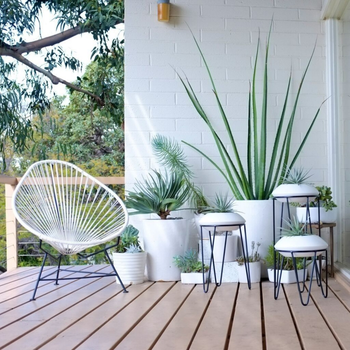 Small patio in white with potted plants minimalist furniture metal chair