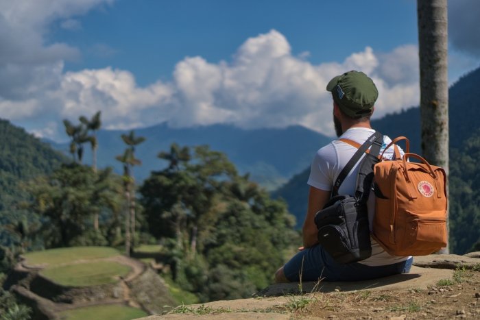Man with a backpack looking at the lost city Colombia ciudad perdida