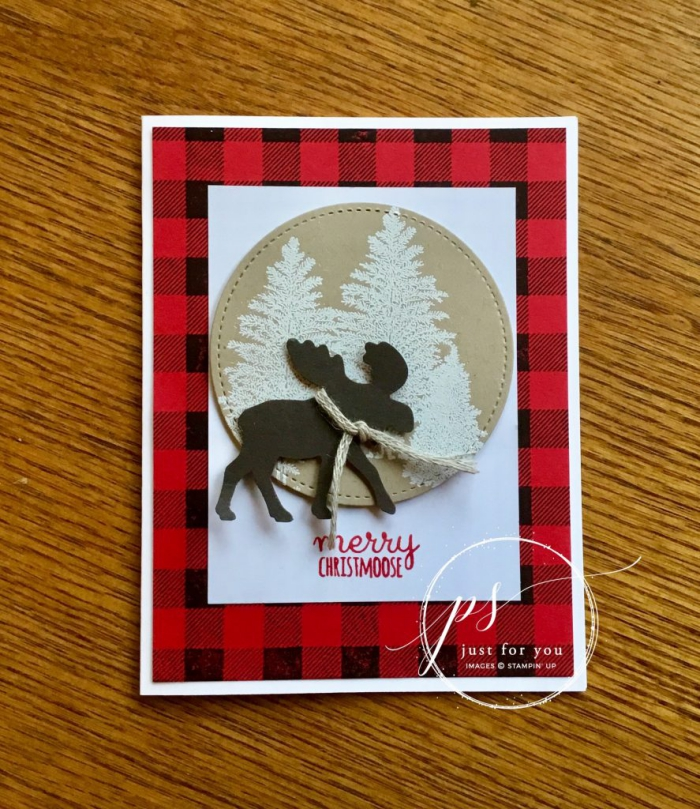 Christmas card with several overlapping patterns and designs reindeer forest checkered background