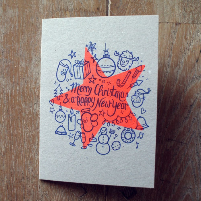 christmas card with overlapping patterns on a wooden surface