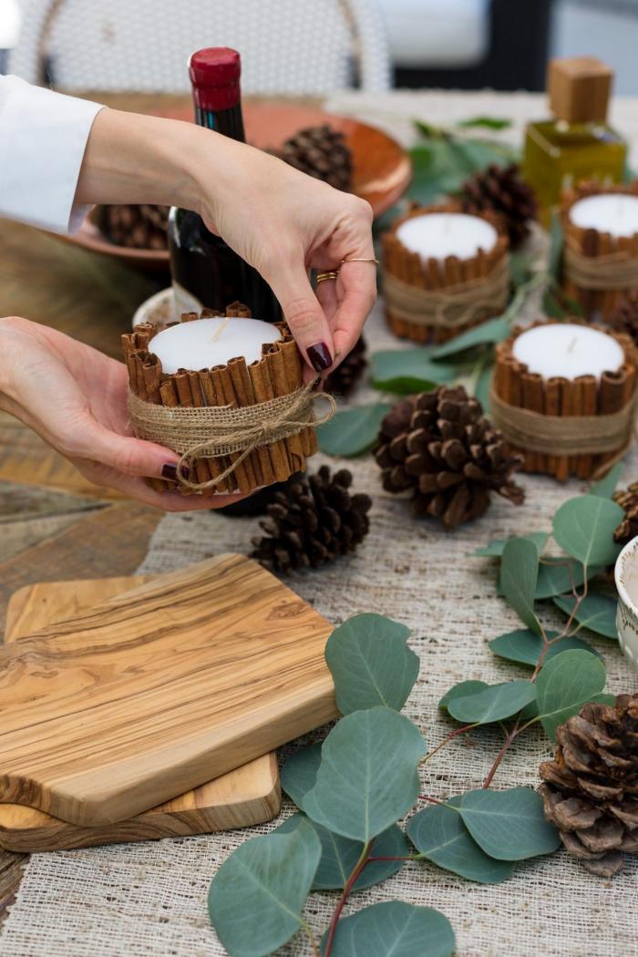 woman cinnamon Christmas table centerpiece diy candle holders pinecones