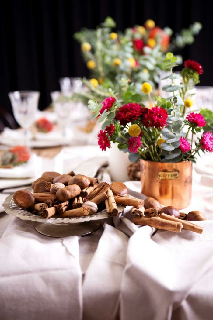 cinnamon and chestnuts table decorations vases with flowers