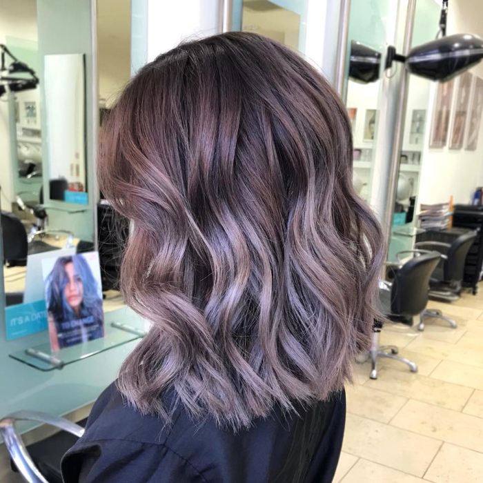 Balayage hair colors lilac woman profile in hair studio middle length waves