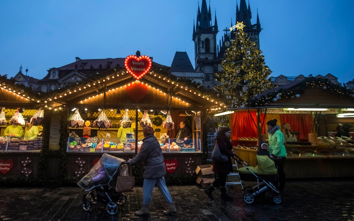 Christmas market in Prague decorated stands in the evening moms with strollers