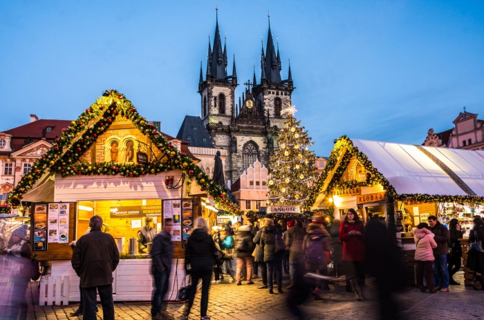 busy Prague Christmas market main square old cathedral decorated stands