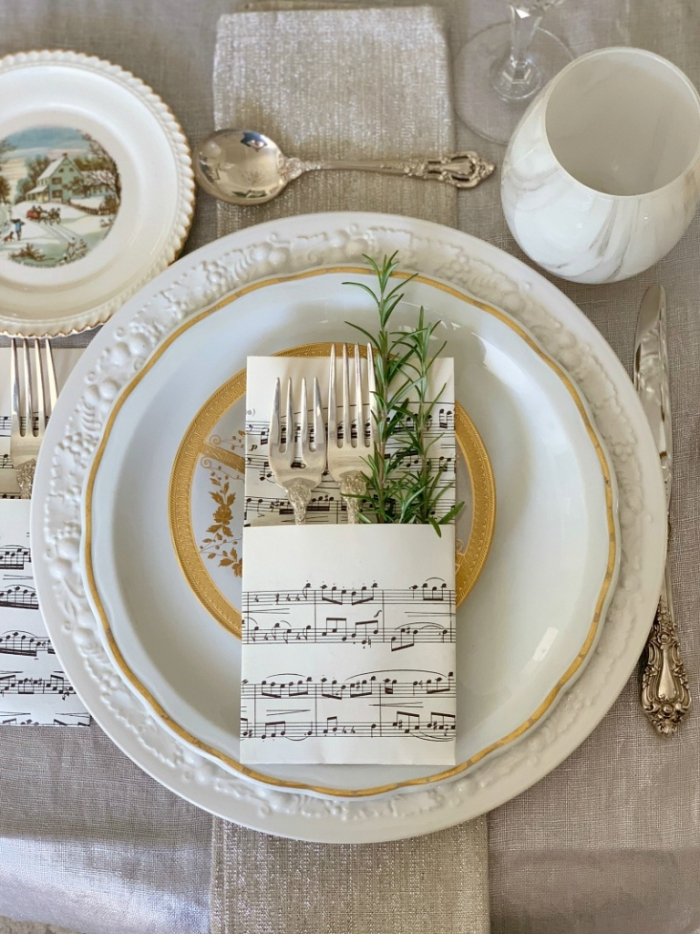 vintage music sheets Christmas table decoration rosemary classic design plates