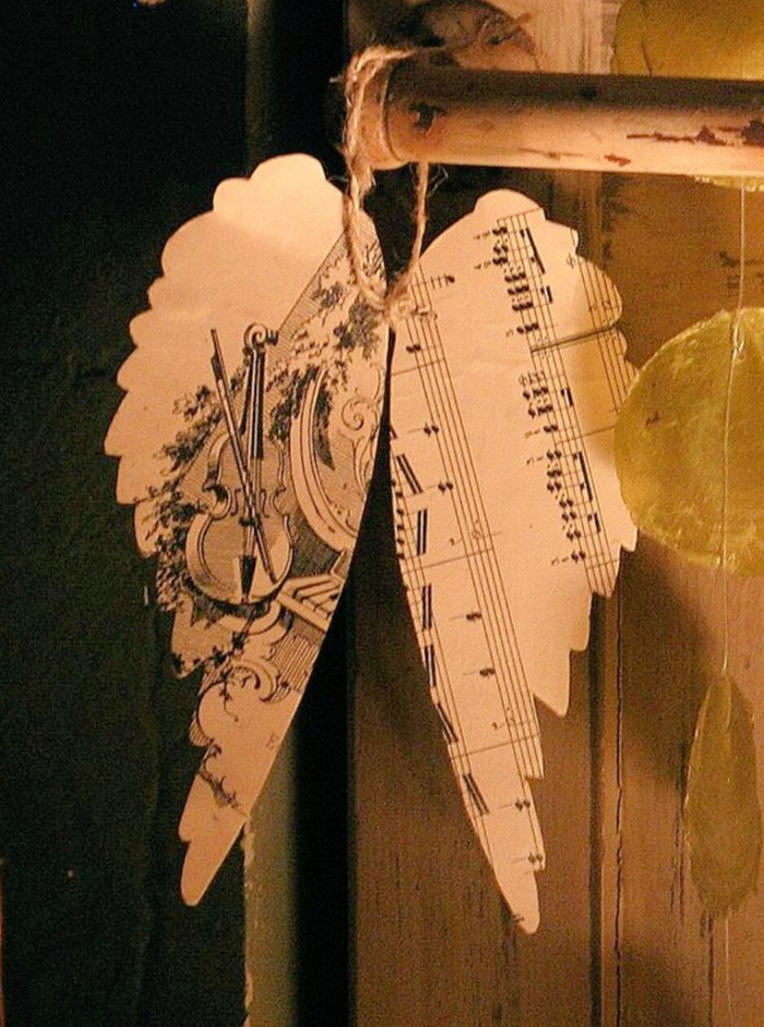 Wings from vintage music sheets rustic Christmas decor