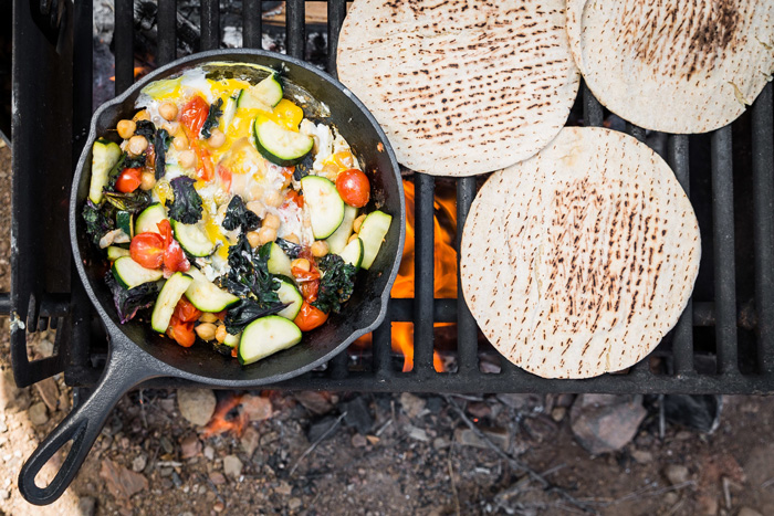 camping food turkey wrap on a fire pan with vegetables
