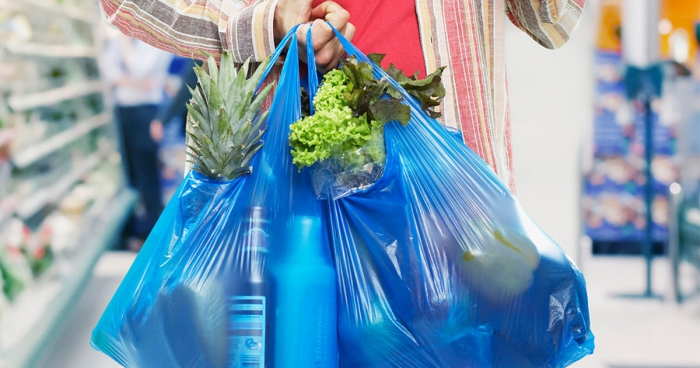 Plastic shopping bags blue bags filled with groceries human carrying bags