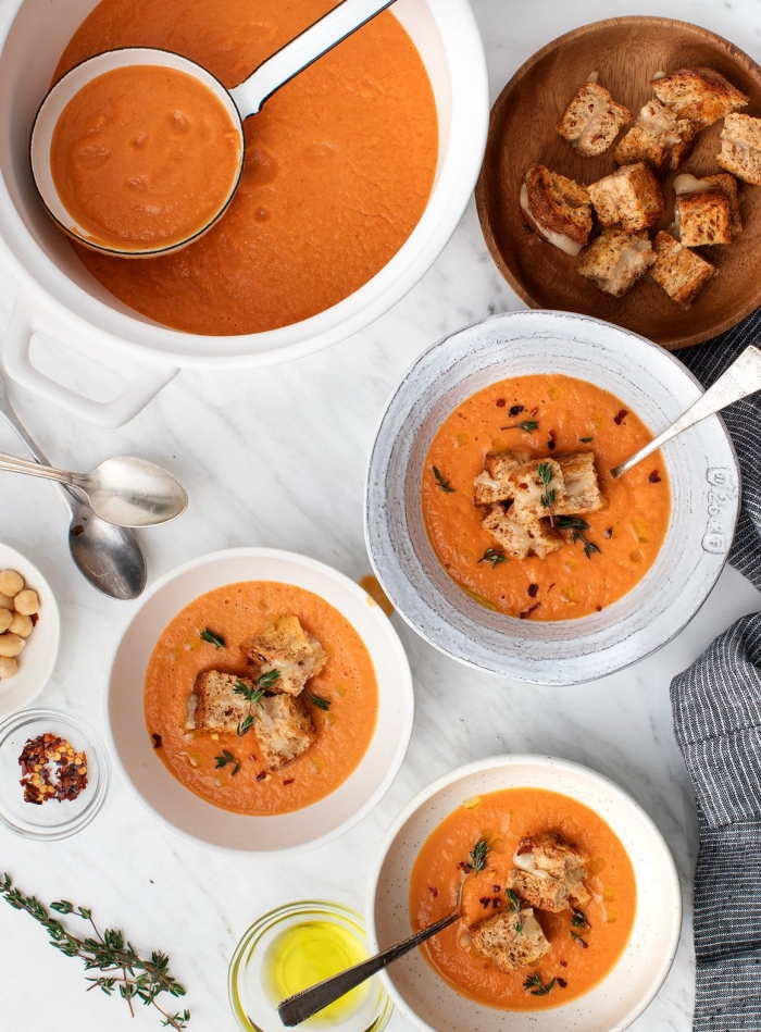 Creamy tomato soup for vegans with crutons on a table