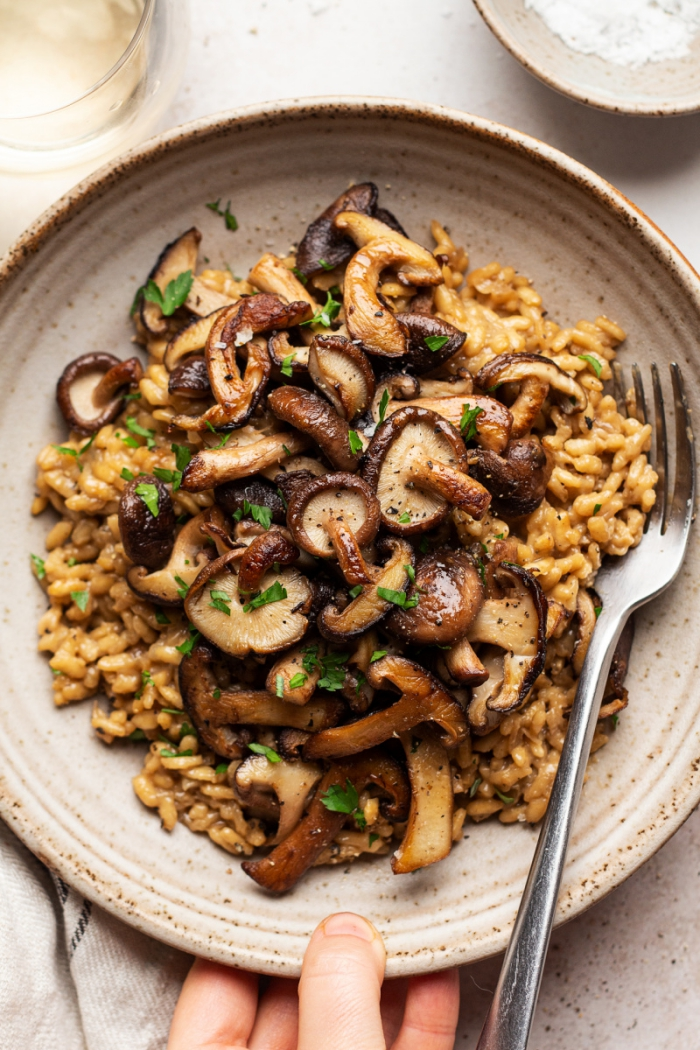 Low Carb Dinners Vegan Risotto with mushrooms on a plate with fork