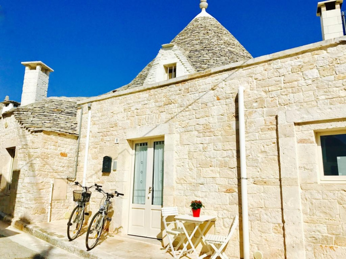 Modern trullo architecture two bycicles stone walls