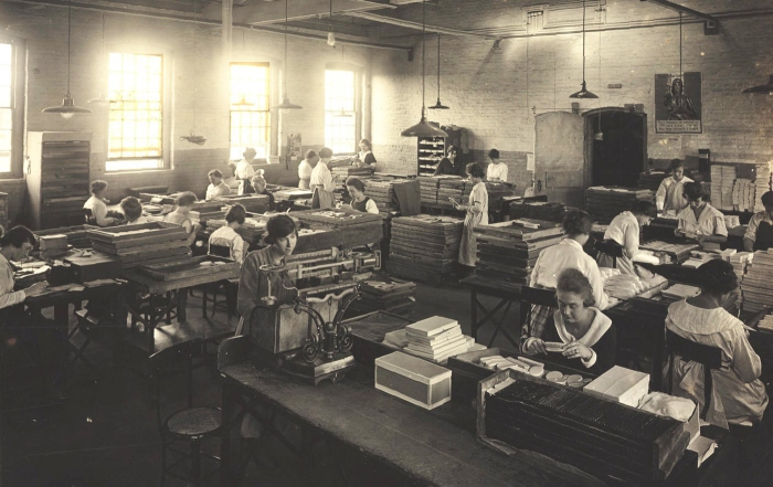 Plastic production in the past factory workers black and white retro photography