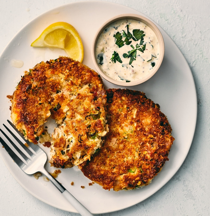Low carb tuna cakes with a fork piece of lemon and a dip