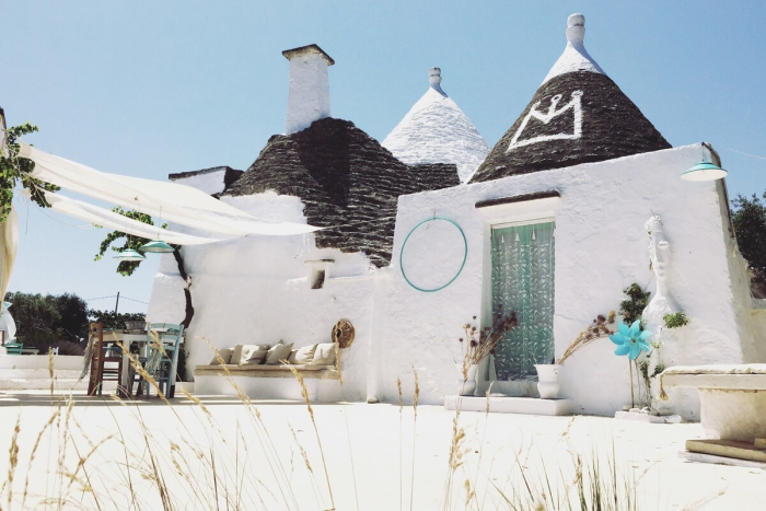 white trullo houses authentic back yard