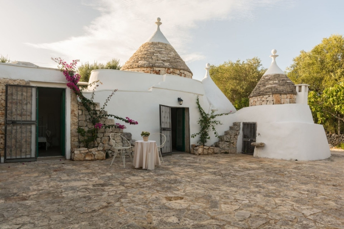 trullo architectural style trulli yard with stones white houses stone roofs