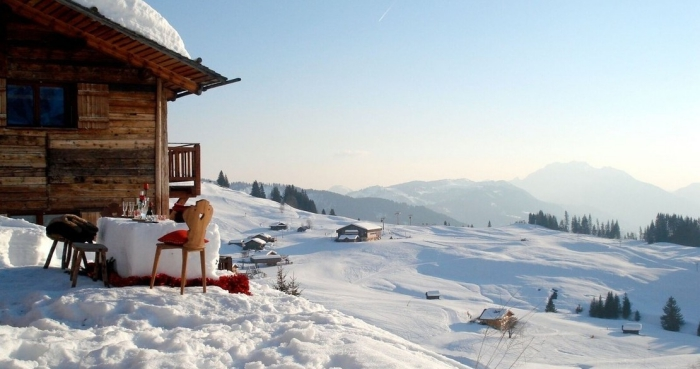 Best cabins for winter break in France snowy landscape and slopes dining table outside