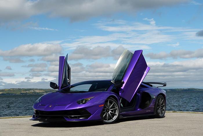 Purple Lamborghini Aventador at the sea shore open doors