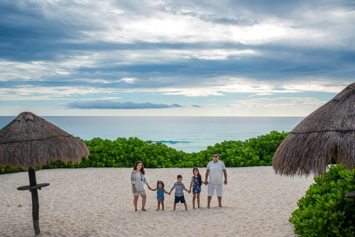 Playa Delfines Cancun family photo family of five white beach greenery
